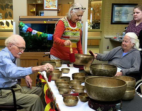 Facility residents enjoying Nancy's Tibetan singing bowls.